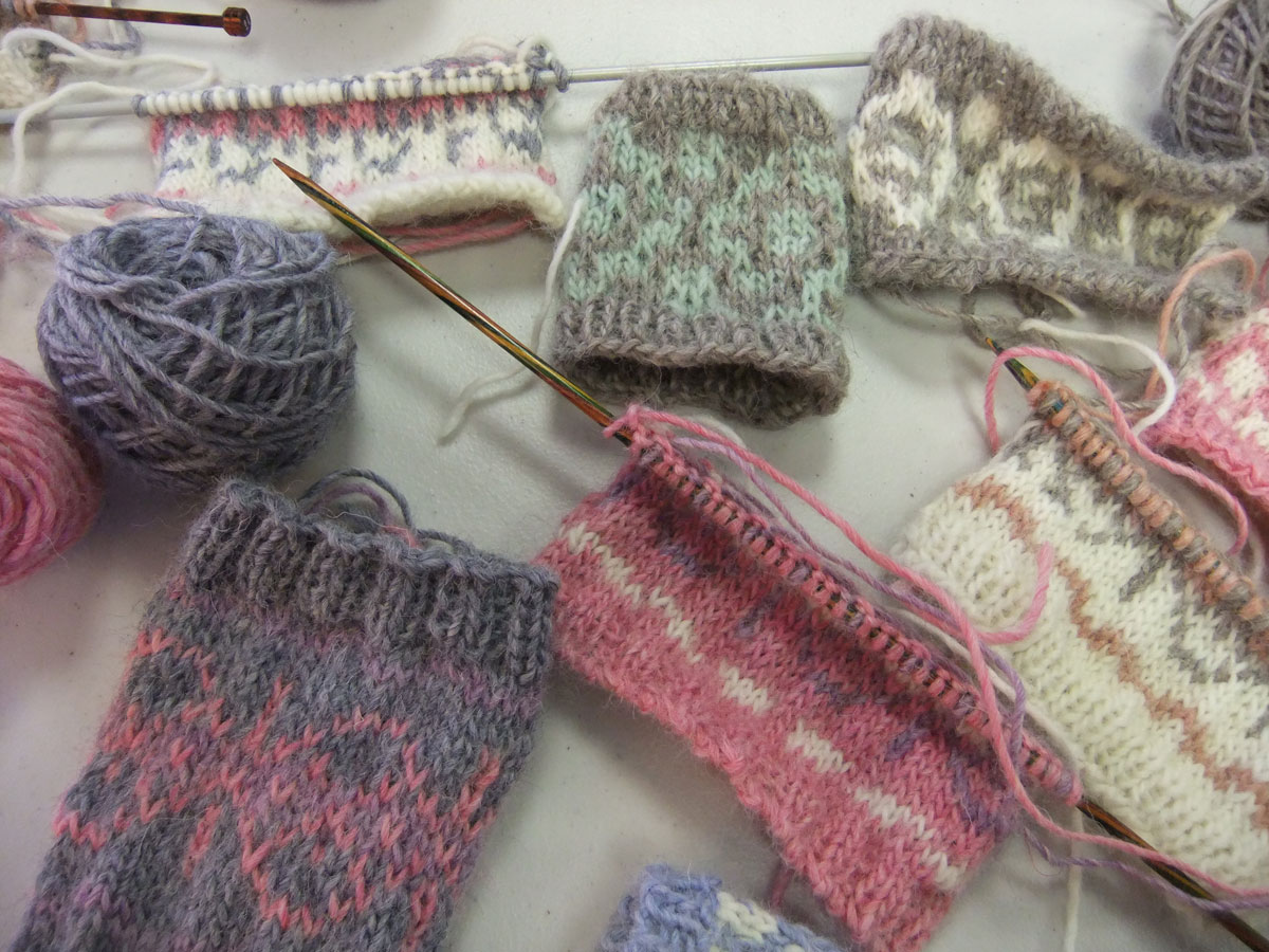 Samples of colourwork knitting from a colourwork workshop taught by Debbie Tomkies at the Yarn Barn