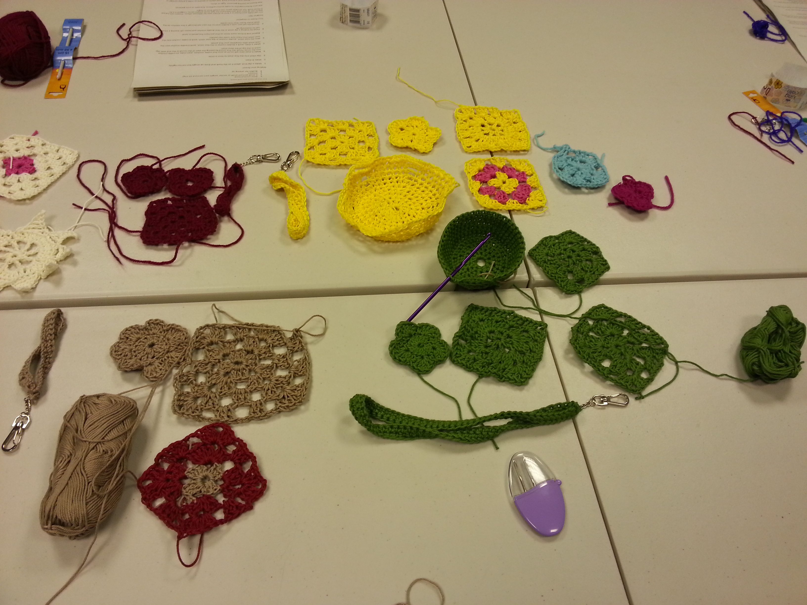 students' work from a beginner's crochet workshop with debbie tomkies of dt craft and design