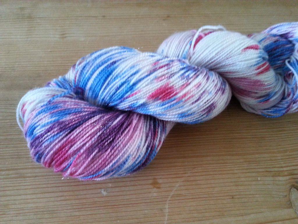 Hand-dyed silver stellina sock yarn
