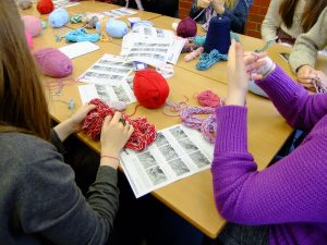 Knitters enjoying a knitting class with Debbie Tomkies of DT Craft and Design